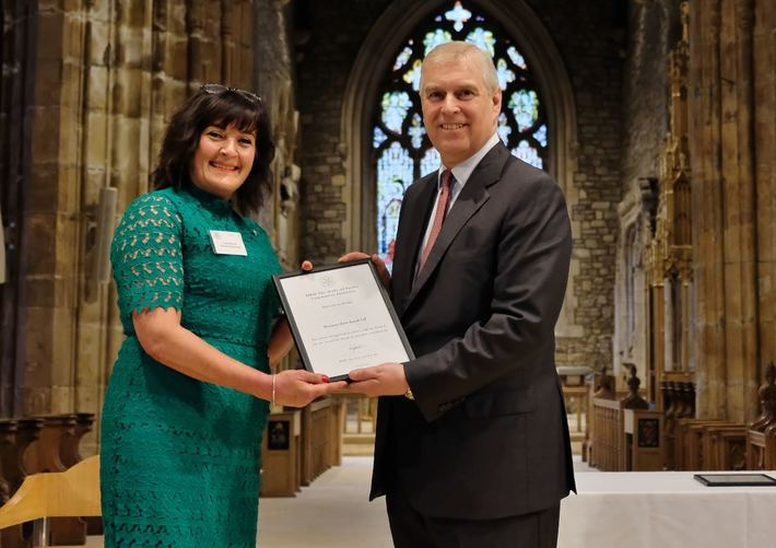 DBA Chair Lesley Hurworth being presented with the DOYCI award by HRH Prince Andrew